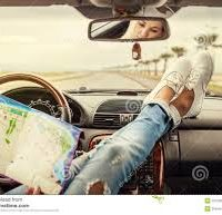 woman and map in car